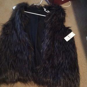 Fur vest. Fake fur. Lined with black inside